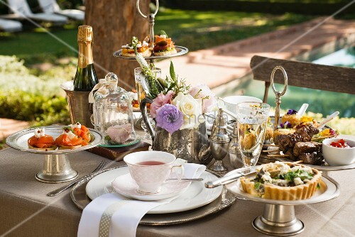 A tea time buffet on a restaurant terrace