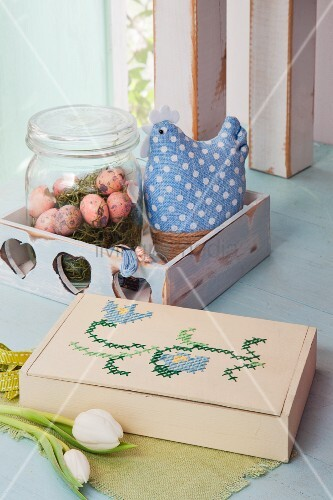 Easter arrangement of embroidered wooden box and vintage accessories