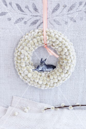 A wreath of catkins with a paper bunny as Easter decoration