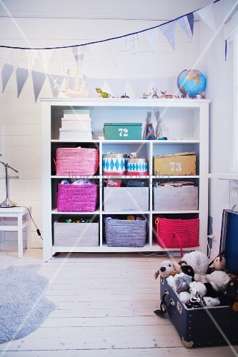 Colourful storage baskets on shelves in child's bedroom