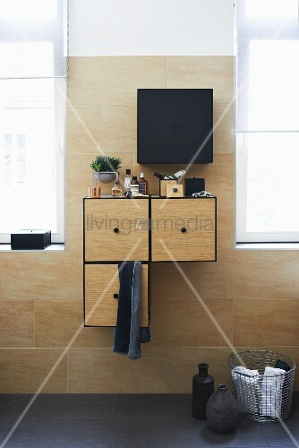 Wall-mounted cabinet in bathroom