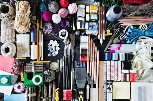 Symbolic DIY image with large selection of craft utensils and accessories