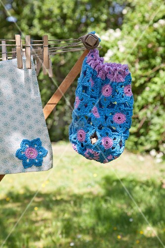 Hand-made, blue and purple peg bag hanging from clotheshorse
