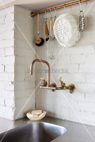 Sink with copper tap fitting and hook rail
