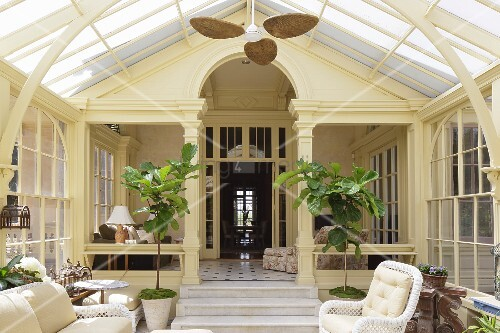 Wicker furniture in Art Nouveau conservatory of classic villa