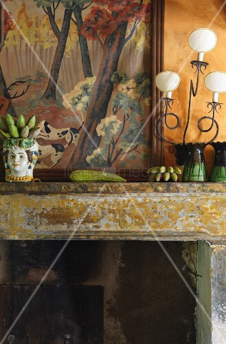 China ornament and vases on mantelpiece with peeling paint
