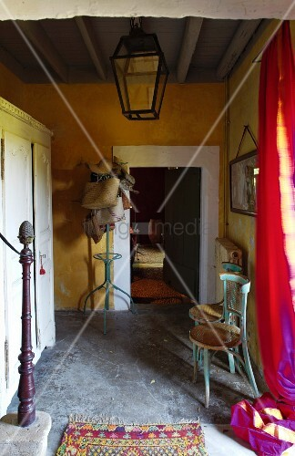 Hallway with ochre-painted walls and lantern hanging from ceiling