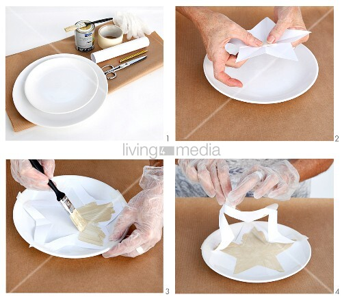 Hand-painting white plates with festive motifs