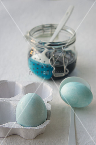 Dying Easter eggs pale blue