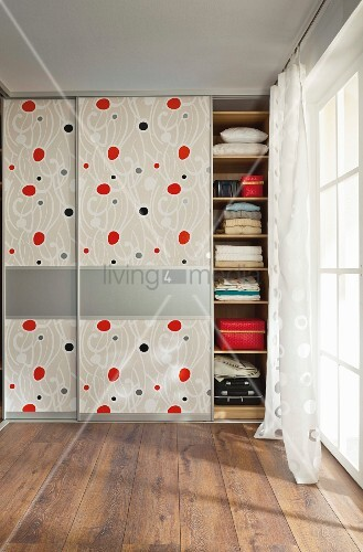 DIY wardrobes with floor-to-ceiling, patterned sliding doors