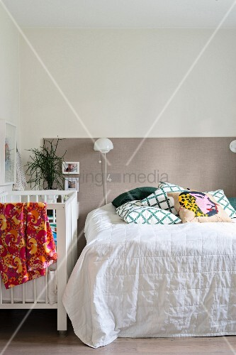 Two-tone wall and cot in bedroom