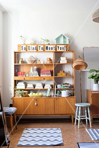Retro wooden shelves and accessories with graphic patterns