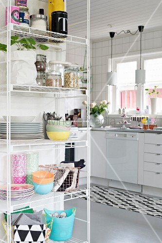 Crockery and supplies on open shelves in kitchen