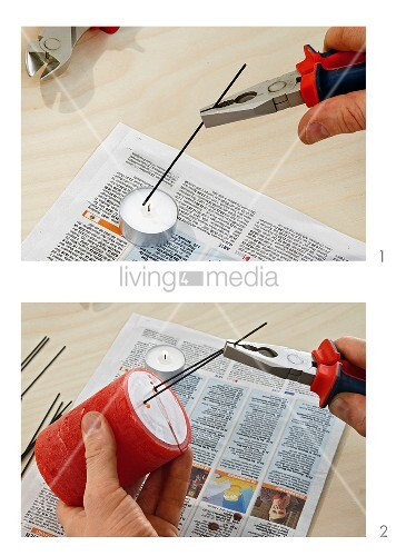 Instructions for preparing red pillar candle for attachment to wreath with heated wire