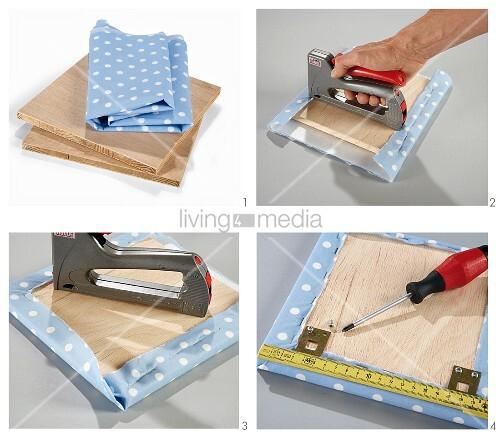 bettkopfteil aus mdf platte und blau weiss gepunktetem stoff herstellen bild kaufen living4media. Black Bedroom Furniture Sets. Home Design Ideas