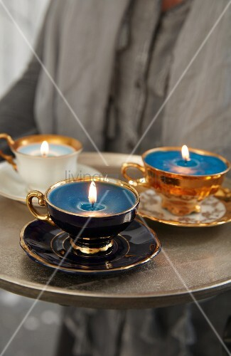 Collective cups filled with wax used as candles on a tray