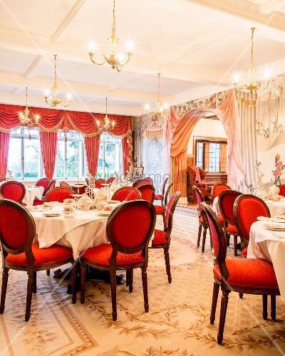 Red medallion chairs in grand, festive dining room