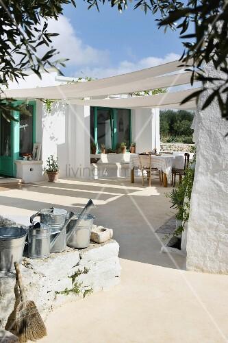 Awning in courtyard of Mediterranean bungalow