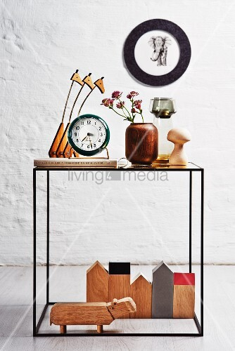 Various wooden ornaments on delicate side table