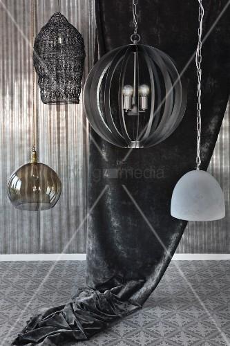 Various pendant lamps in grey interior