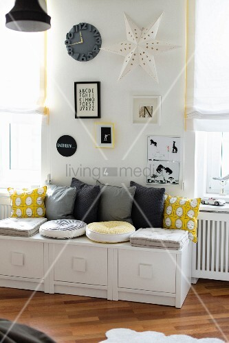 Modern bench with grey and yellow cushions