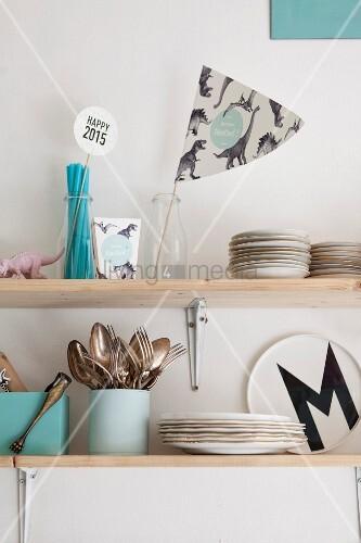 Light blue kitchen accessories on shelves