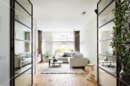 View into modern living room through glass doors