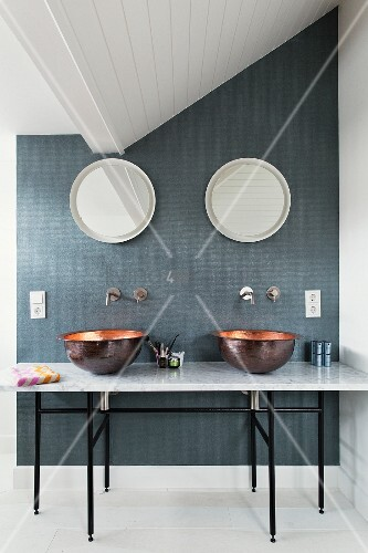 Marble washstand with twin countertop basins in modern bathroom