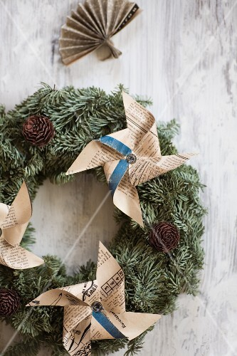 Wreath decorated with windmills made from yellowed newspaper