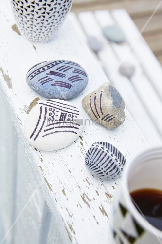 Pebbles painted with patterns of stripes