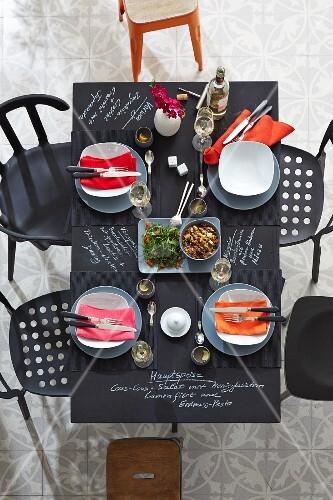 Set chalkboard table with menu written in white