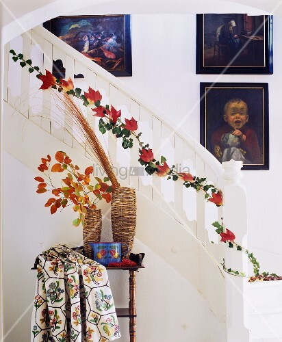 Garland of ivy and autumn leaves wound along banister