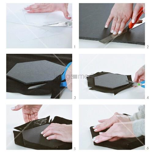 Wabenförmige Pinn-Tafeln basteln und mit grauem Stoff beziehen