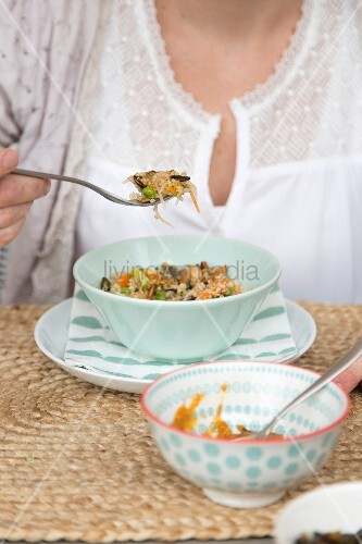 Woman eating vegetarian dish