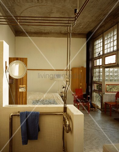Open, improvised shower in the sleeping quarters of an industrial hall