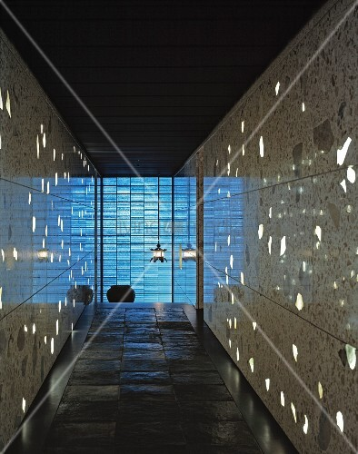 Hallway with light reflecting off the stone wall tiles and slate ...