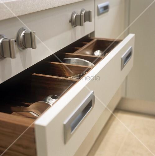 An open cutlery drawer