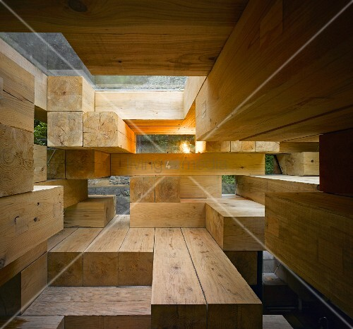 A Japanese house with step-like construction made of wooden beams