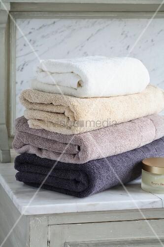 Stack of towels on bathroom cupboard