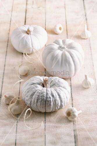 Halloween decorations: white pumpkins and garlic