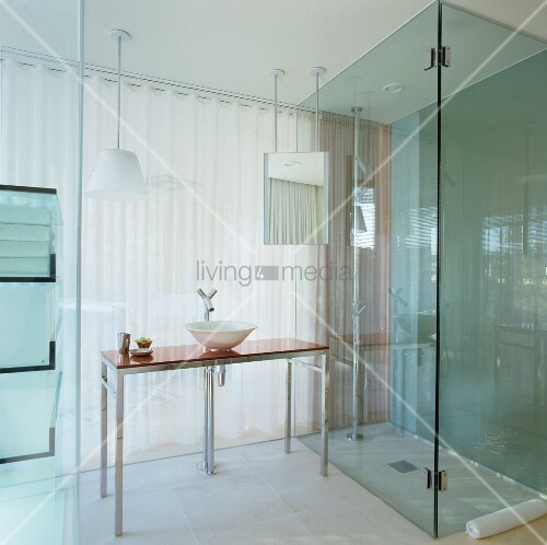 Glass Ensuite Hotel Bathroom With Floor Level Shower And Modern Washstand Philippe Starck Tap Fittings In Front Of Translucent Curtain Leading To