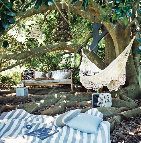 Garden corner for relaxing with bench, hammock and blanket