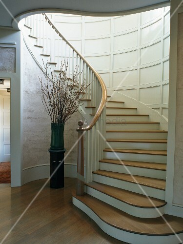 Curved staircase in cylindrical stairwell