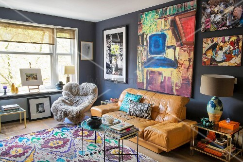 Artworks on wall of colourful, eclectic, artistic living room
