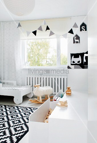 Rocking sheep in monochrome child's bedroom