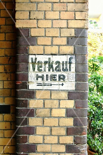Old painted sign on brick façade