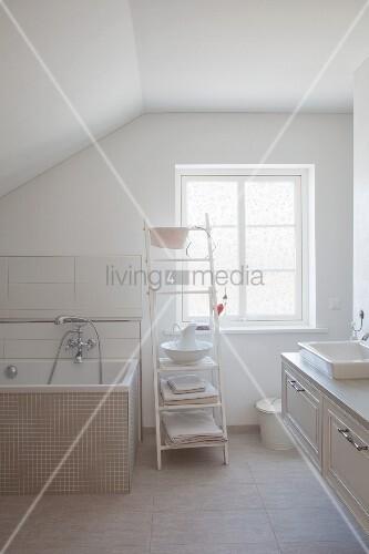 Attic bathroom with vintage ambiance