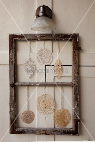 Decoration made from vintage picture frame and crocheted doilies
