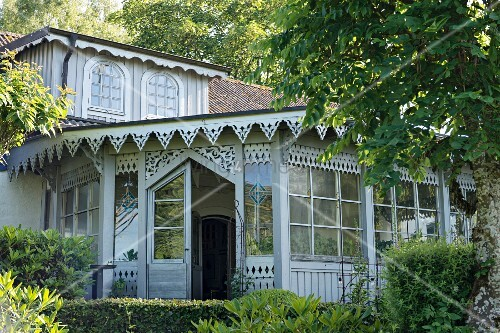 Vintage-style wooden façade with ornate eaves and lattice windows