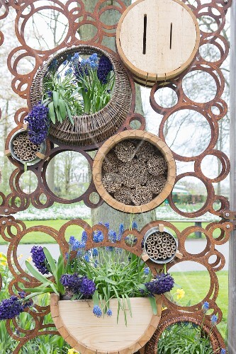 Rusty metal screen with circular motif and flowers